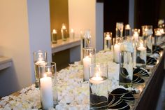 White rose petals, floating candles and ceremony kippahs.  By Edmonson Photography.