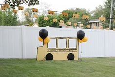 School Bus party decorations. Families posed in the school bus for pictures.