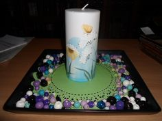 Decoration with a green doily, multi coloured beads and a handpainted candle.