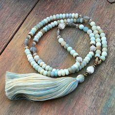 Mala necklace made of 5 x 8 mm - 0.196 x 0.315 inch and 8 mm - 0.315 inch beautiful frosted amazonite gemstones. Together they count as 108 beads.