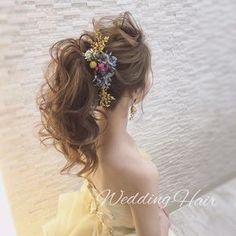 王道アップスタイルのふわふわポニーテルのブライダルヘアまとめ   marry[マリー]