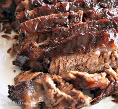Tender oven cooked barbecue brisket is marinated with simple ingredients overnight and baked for hours for melt in your mouth tender meat! This baked brisket recipe is simple to make and tastes delicious! Oven Cooked Brisket, Beef Brisket Recipes, Bbq Brisket, Meat Recipes, Cooking Recipes, Recipes Dinner, Brisket In The Oven, Brisket In Roaster Oven, Healthy Recipes