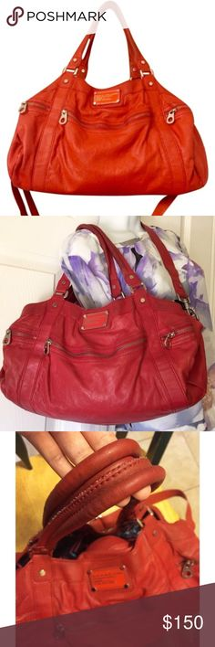 Marc Jacob purse Greet the season in this Leather Satchel by Marc Jacobs in bright red. Slight fading as pictured. Double handles and a longer detachable straps. Three front exterior pockets including front and back. Interior several pockets and overall spacious bag. Great bag for years to come. Bags Shoulder Bags