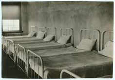 Vintage hospital beds - there is something almost sinister about this sparse scene...a loneliness, a sadness. Capture this in your written description.