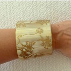 {anthro} Pono Etched Gold Fairies Horn Cuff Amazing carved horn cuff from Pono. Gold fairy motif. Perfect condition! Anthropologie Jewelry Bracelets
