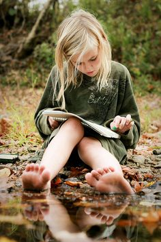Talia, (girl who finds Alice) when she was little, before she ran away. She is also called Waterlily.