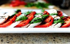 This Caprese Salad is as simple as it gets. A great starter for any summer lunch or dinner. It is always a hit on the table and can be made in just a few minutes. Method: Cut the fresh mozzarella in slices and place them on individual serving plates. Layer finely sliced tomatoes in between mozzarella slices. Decorate with basil leaves and drizzle olive oil on each plate with a few drops of balsamic vinegar. Presto! Serve all ingredients fresh and slightly cool.