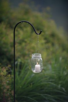 hanging mason jar candle. Perfect for an evening when friends are coming. Would look lovely along my walkway up to the frent door.