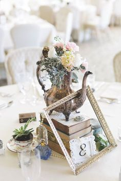 Vintage table scape one of a kind decor from Rent My Dust vintage rentals Romantic Garden Wedding, Silver teapot, pearls perfume bottles, lace, teacups tea party wedding