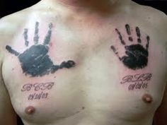 The second of my handprint tattoos is this cool pair of breast tattoo designs.