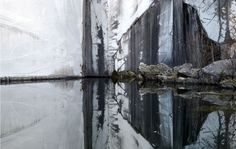Photography   Jacob Cartwright  Reflection in the pooled water of an abandoned marble quarry in Carrara, italy