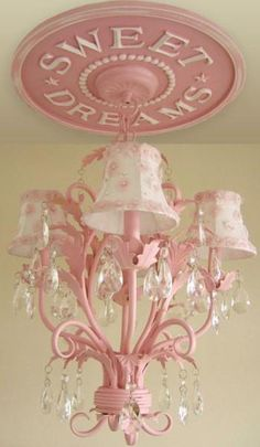 Ceiling medallion painted to match the chandelier and wooden letters glued on ties the whole room together. So cute!