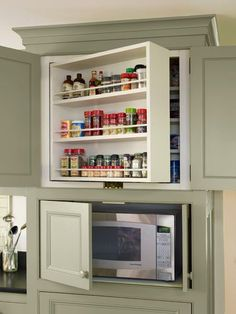 organized pantry and kitchen space. kitchen cabinets with swing out shelves and microwave storage, whole house remodel farmhouse addition Farmhouse Kitchen Cabinets, Kitchen Cabinetry, Kitchen Redo, Kitchen Pantry, Kitchen Storage, Microwave Storage, Kitchen Ideas, Hidden Microwave, Microwave Cabinet