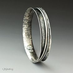 For those bangle lovers, this sterling silver bracelet is great worn alone or can be stacked with other bangles. The inner bangles are made of 2 mm