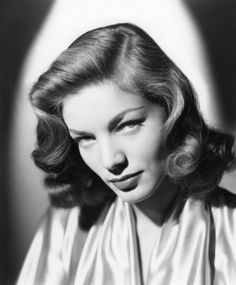 Lauren Bacall's signature medium length hair style, Hollywood glamour of yesteryears.