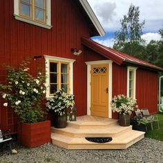 Boost your home's curb appeal with these 23 exterior paint color ideas - Rich burgundy accented by mustard yellow. Swedish Cottage, Red Cottage, Swedish House, Red Houses, Exterior Paint Colors For House, House Siding, Cabins And Cottages, Architecture, House Painting