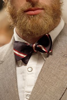 cool: modern fabric for the suit + the buttons, plus scruffy facial hair
