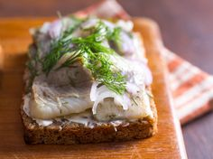 This classic Danish open-faced sandwiche features pickled herring with rich butter and dense, tangy sourdough rye bread.