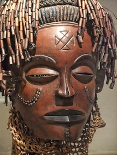 Africa | Mask Chokwe Angola or Democratic Republic of Congo Late 19th-Early 20th century Wood fiber beads and pigment |   Photographed at the Art Institute of Chicago, Chicago, Illinois.
