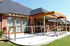 Well, it's been a few weeks since we've had a patio update. As a reminder or if you're new here, we tore out our previous existing pergola and covered patio and are starting almost from scratch to… Pergola Carport, Steel Pergola, Pergola With Roof, Outdoor Pergola, Backyard Pergola, Patio Roof, Pergola Plans, Pergola Ideas, Pergola Shade