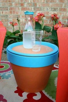 Painted terracotta pot with saucer on top as outdoor end table!