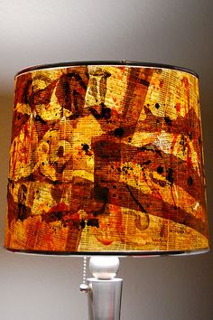 Lamp shade made with old phone book pages! Just think of what else you could use instead of a phone book!!