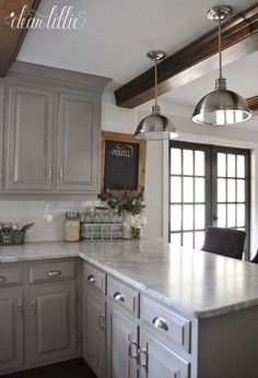 Love the gray cabinets! The Finishing Touches on Our Kitchen Makeover (Before and Afters) by Dear Lillie