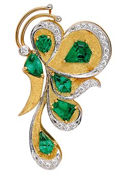 An Emerald, Diamond, Platinum and Gold Butterfly Brooch/Pendant, Cavelti  Designed as a butterfly decorated with variously-cut emeralds and diamond trims, matte textured and polished details, concealed bail to the reverse, mounted in platinum and 18k gold, signed Cavelti, Birks.