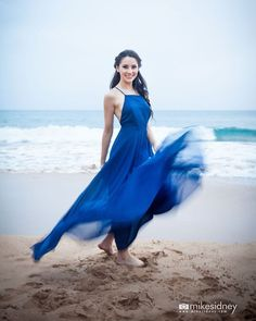 Great smile and check out the motion blur of the dress! Nicely done!