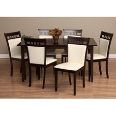 @Overstock - Update your dining room's look with this elegant seven-piece dining set, which includes a table and six chairs. The dark oak wood with cappuccino finish contrasts beautifully with the chalk-colored fabric on the chairs and is sure to match your decor.http://www.overstock.com/Home-Garden/Warehouse-of-Tiffany-Shirlyn-7-piece-Dining-Furniture-Set/6378857/product.html?CID=214117 $699.99