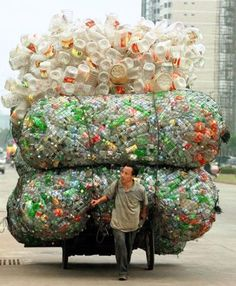 A Chinese man transports plastic bottles and containers for recycling in Haikou, the capital of China's southern Hainan province. Plastic Pollution, Bizarre, Wise Owl, People Of The World, Plastic Bottles, Water Bottles, Empty Bottles, Belle Photo, Mother Earth