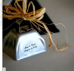 """Bells as the """"send off"""" and as wedding favors. Use clear sticker with couples' names on it and tie with ribbon. Love it!"""