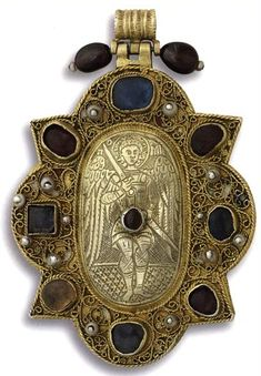The pendant, arch angel Michael ,  Cameos from aimatitῃ, silver gilt, filigree, precious stones, pearls, enamel trace . Cameo is from the 12th century and the rest of the piece is from the late 15th century to early 16th century.