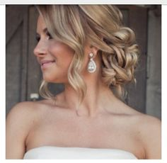 Loose up do- like the bun/curls to the side