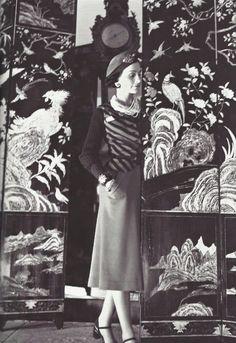 Boris Lipnitzki-Coco Chanel before her Coromandel screens, 1937