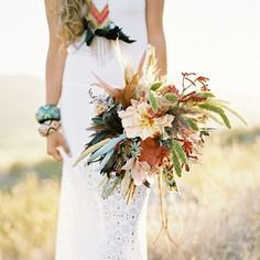 If you are looking at an ivory or white wedding dress then the colors of fall will combine fabulously for you,Ivory and white and orange bouquet ideas,bride