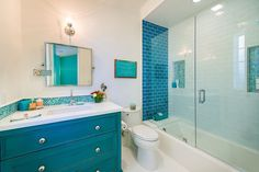Teal blue and white kids' bathroom - A House in Manhattan Beach That Loves the Blues | Hooked on Houses