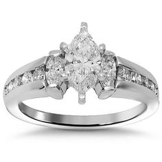 This simple yet elegant womens engagement ring is handcrafted in lustrous 14K white gold. The center is set with one marquise cut diamond which weighs 0.72 carats and its G in color and SI! in clarity. The side stones consist of two smaller marquise cut diamonds and channel set round cut diamonds. The frame measures to 3/8 inches in width and weighs 5 grams. $3,737.00