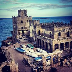 A haunting ruin - the crumbling Italian lighthouse perched on the edge of Mogadishu's Old Harbor was built over a century ago, and abandoned some 20 years ago as trade dried up and the failed state of Somalia descended into war and piracy. Mogadishu, Somalia.