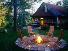 A gorgeous backyard fire pit- I like the idea of stepping stones around the pit!