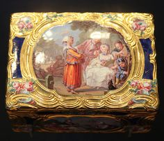 Snuffbox with Hurdy-Gurdy Player - V, 1760-1, Paris, France; mark of Jean Fremin (active 1738-86)  Enamels signed 'Le Sueur', scene on back after The Little Flute Player and his Dog by Francois Boucher (1703-70).  Enamelled gold. Formerly in the collection of Baron Gustave de Rothschild (1829-1911)