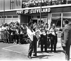 Ward 16 Councilman Jack P. Russell, a Hungarian-American from the Buckeye Road area, gets a musical send-off at Cleveland Hopkins Airport from Hungarian violinsts as he prepares to fly to Budapest, the capital of Hungary, in 1962.  Photo by Noble, Bernie, 1962-07-11  Cleveland Press Collection