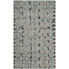 Anchor your living room seating group or define space in the den with this hand-tufted wool rug, featuring a dip dyed design in grey and charcoal.