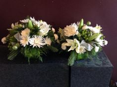 Matching table centerpieces for a holiday festive dinner with friends and family.