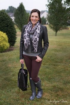 Fall Fashion for Women Over 40: Rain boots with plum skinny jeans, grey animal print scarf and moto jacket