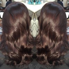 Deep chocolate brown with red-violet undertones