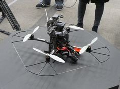 A surveilance quadcopter with a laser scanner on top