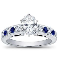 Milgrain and Pave Sapphire Engagement Ring with an Oval Diamond