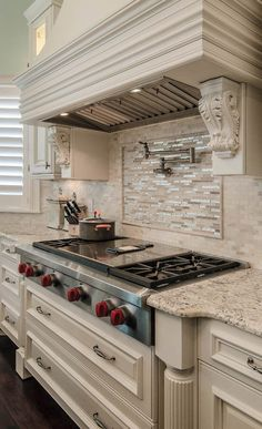The homeowners wanted a range with a central griddle and four burners, as well as a pullout microwave drawer to preserve space. The large wine fridge and the built-in coffee maker have become two of the homeowners' most beloved conveniences.  #housetrends #kitchen