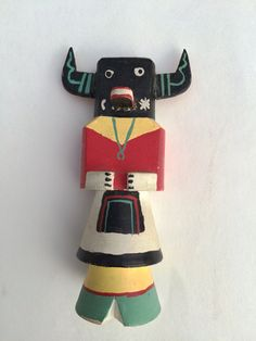 This vintage Route 66 Kachina (Katsina) doll is a traditional Hopi Tihu (carved doll made out of wood) created and sold for the tourist